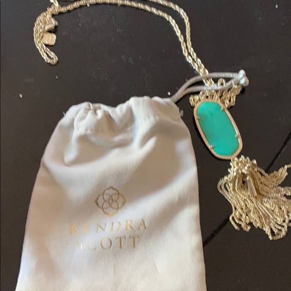 Kendra Scott necklace. Gold with stone.